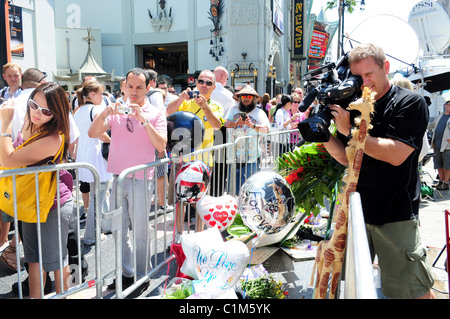 Fans from all over the world gather to pay their respects to Michael Jackson by his star on the Hollywood walk of - Stock Photo