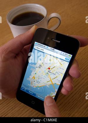 Navigation of New York City Manhattan using Google maps app on an Apple iphone 4G smart phone - Stock Photo