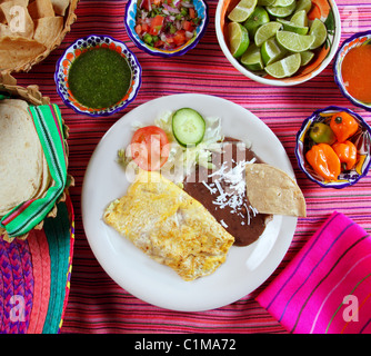 breakfast in mexico omelette eggs with chili sauce Mexican food - Stock Photo
