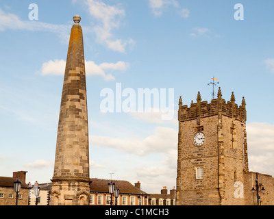 Holy Trinity Church and the octagonal sandstone obelisk rebuilt 1771 in the market place Richmond North Yorkshire - Stock Photo