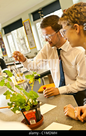 Two sixth form Pupils doing an experiment in a A level biology science practical class in a secondary school UK - Stock Photo