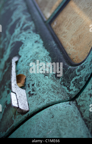 Frost covered old wrecked abandoned Skoda in the Slovakian village of Stara Lesna - Stock Photo