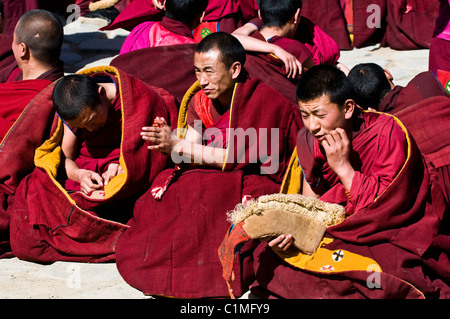Yellow hats ( Gelugpa ) TIbetan monks during ceremony in Labrang monastery in eastern Tibet. ( Gansu province ) - Stock Photo