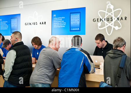 Customers explore the iPad in an Apple store on launch day, Cherry Hill Mall, New Jersey, USA. - Stock Photo