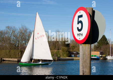 Pensioners sailing a boat on the Norfolk broads - Stock Photo