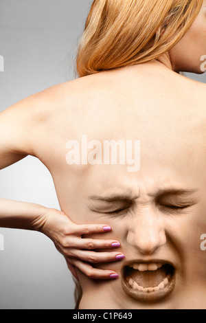 Back pain concept - waist spine in agony - Stock Photo