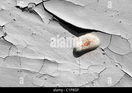 Dry, cracked weathered ground in the badlands near Drumheller, Alberta, Canada. - Stock Photo