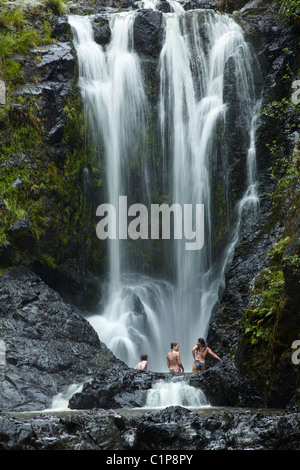 Girls swimming at Piroa Falls, Waipu Gorge, near Whangarei, Northland, North Island, New Zealand - Stock Photo