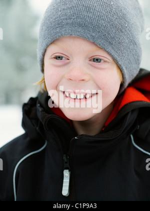 Portrait of boy wearing wooly hat - Stock Photo