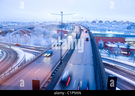Traffic on elevated road at dusk - Stock Photo