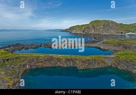 Disused slate quarries on the island of Easdale south of Oban in Scotland - Stock Photo
