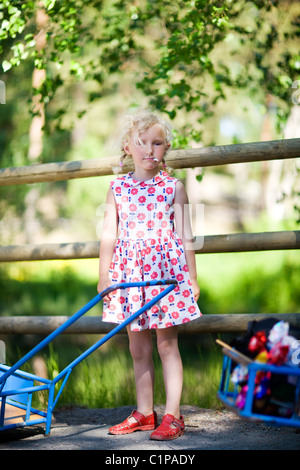 Portrait of girl standing by fence at zoo Stock Photo