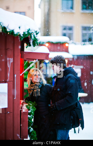 Couple in front of food stall - Stock Photo