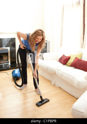 Young Happy Woman Cleaning Floor On Her Knees Stock Photo