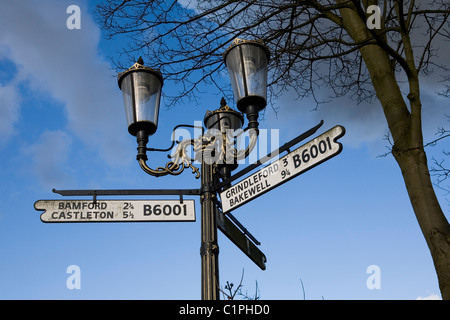 England, Derbyshire, Hathersage, road signs on Victorian lamppost - Stock Photo