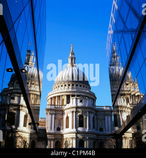 A view of St Pauls Cathedral and reflection of the building on glass walls of  One New Change shopping mall in Central - Stock Photo
