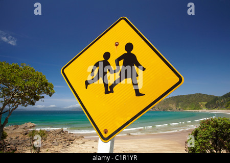 Children warning sign and Long Beach, Oneroa Bay, Russell, Bay of Islands, Northland, North Island, New Zealand - Stock Photo