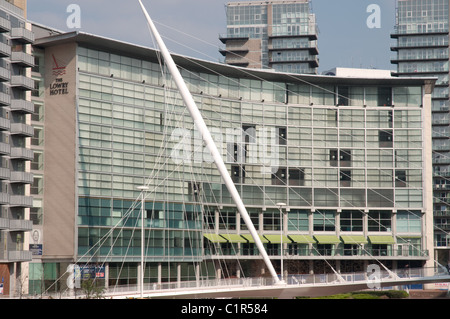 The Lowry 5 star Hotel.In foreground is Santiago Calatrava's Trinity Bridge over the River Irwell linking Manchester - Stock Photo