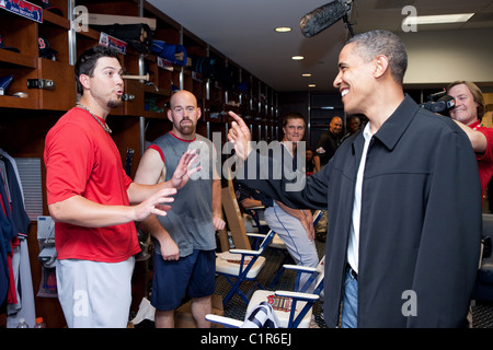 President Barack Obama gets some throwing advice from Red Sox pitcher Josh Beckett, left, while visiting the American - Stock Photo
