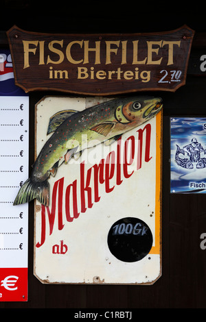 A sign advertises fish fillet in a beer batter at the Oktoberfest in Munich, Germany. - Stock Photo