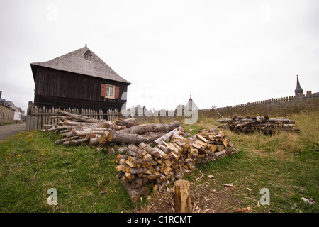 Freshly chopped pile of firewood at Fortress of Louisbourg National Historic Site, Cape Breton, Nova Scotia, Canada - Stock Photo