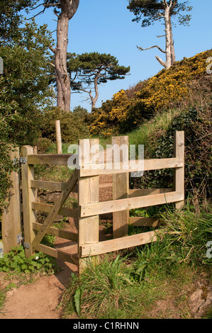 A ' kissing gate ' on the south west coast path near St.Anthony on the Roseland Peninsula in Cornwall, UK - Stock Photo