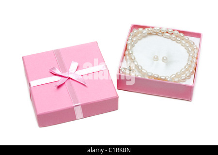 Gift box with necklace from pearl on white background - Stock Photo
