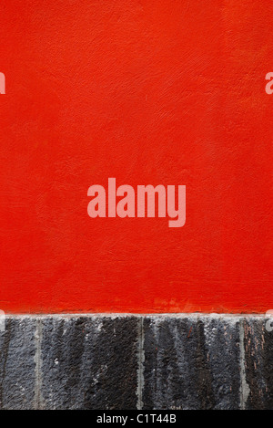 Red stucco wall, close-up - Stock Photo