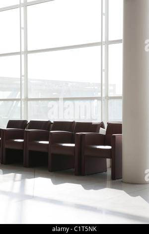 Empty armchairs in lobby - Stock Photo