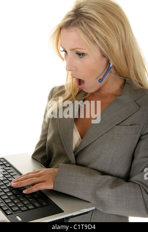 Beautiful blond customer service representative has a shocked or surprised facial expression. - Stock Photo