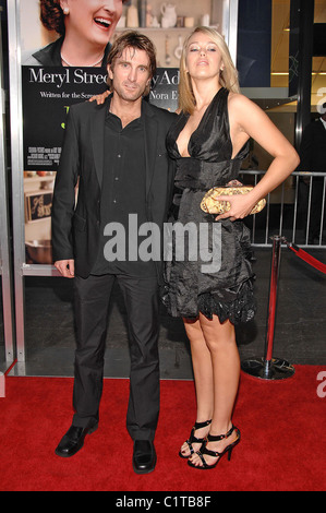 Sharlto Copley and guest attends the 'Julie & Julia' premiere at the Ziegfeld Theatre - Arrivals New York City, - Stock Photo