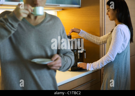 Couple enjoying coffee in kitchen - Stock Photo
