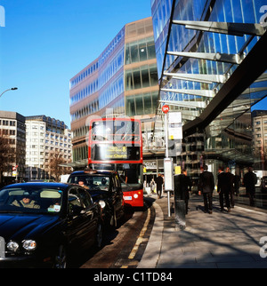A view of traffic and pedestrians near One New Change shopping development Cheapside London England, UK - Stock Photo