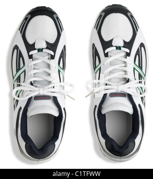 a pair of unbranded training shoes isolated on a white background from overhead - Stock Photo