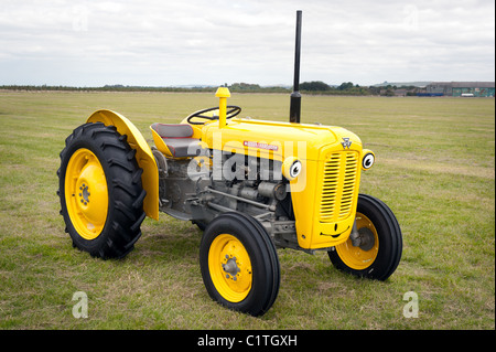 A Massey Ferguson Model 35 painted yellow and grey with a smiley face - Stock Photo