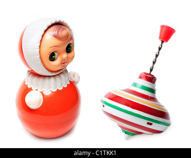 Collage aging doll and toy whirligig on white background - Stock Photo