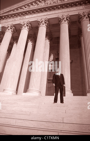 US Supreme Court with Attorney standing on steps.  Sepia toned photograph.  Low wide angle view - Stock Photo