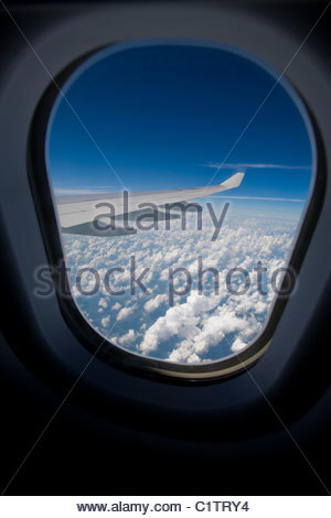 View through an airplane window during flight - Stock Photo