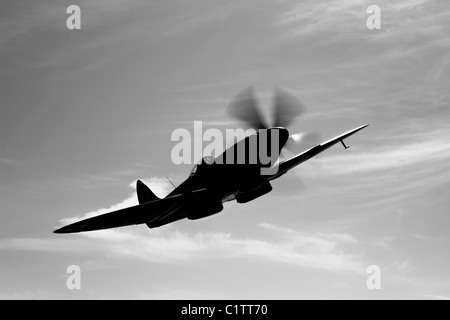 A Supermarine Spitfire Mk-18 in flight near West Chester County, Pennsylvania. - Stock Photo
