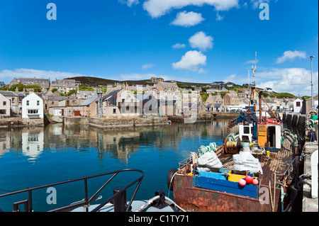 Fishing boats moored in Stromness Harbour on the Orkney Mainland in Scotland - Stock Photo