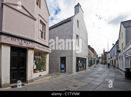 Pedestrianised Albert Street in Kirkwall Orkney Mainland Scotland with Trenabies Bistro - Stock Photo