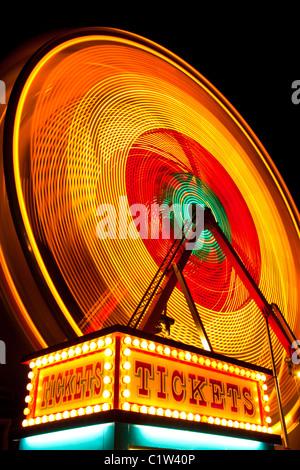 long-exposure of ferris wheel at night - Stock Photo