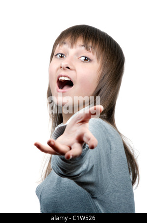 Young beautiful girl sings with extended onward by hand - Stock Photo