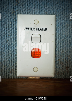 Water heater power switch - Stock Photo