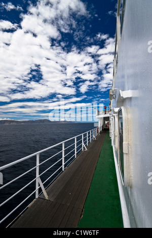 Deck of large ferry with ocean and blue sky. Portrait composition. - Stock Photo
