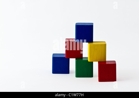 Colorful building blocks arranged as a pyramid. isolated on white. - Stock Photo