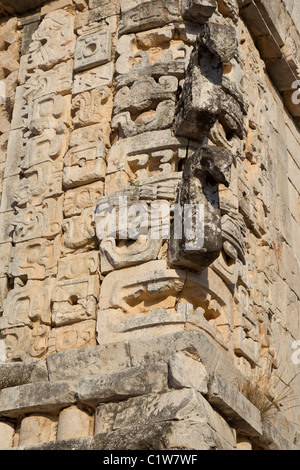 Intricate facade of Chac masks in the Nunnery Quadrangle in the Puuc style Maya ruins of Uxmal, Mexico. - Stock Photo