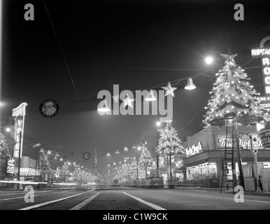 USA, California, Los Angeles, Hollywood, Hollywood Boulevard at night looking East showing Christmas lights - Stock Photo