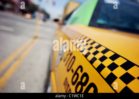 Close-up of a checkered taxi cab shot from the rear in Santa Monica, CA - Stock Photo
