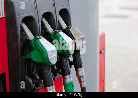 Close-up of a gasoline pumps nozzles in a petrol station - Stock Photo